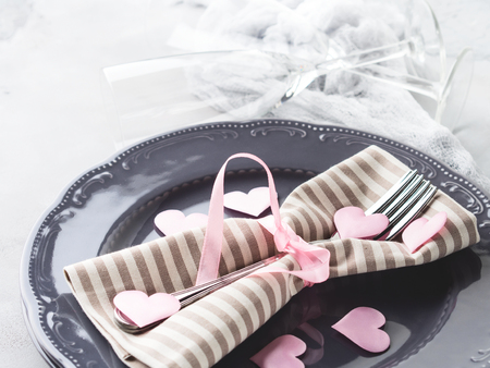 wedding feast: Romantic dinner date plates hearts love symbol with champagne glasses on gray. Valentines woman day