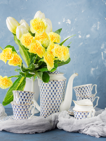 Coffee tea party china set and easter pastel color yellow flowers coffee tea party china set and easter pastel color yellow flowers on blue festive holiday mightylinksfo