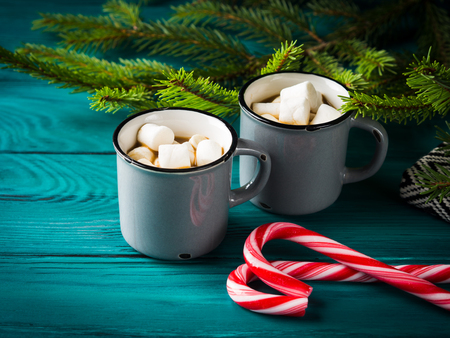 Hot chocolate with marshmallows on dark green. Christmas festive winter drink background Stock Photo
