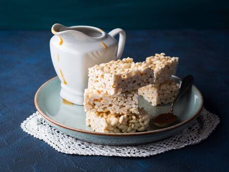 Sweet puffed rice marshmallow bars served with salted caramel