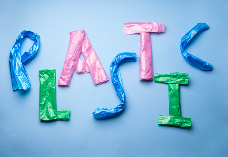 Word Plastic written with plastic bag letters on blue background Stock Photo