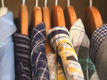 Mans closet. Hangers with shirts closeup. Male wardrobe Archivio Fotografico
