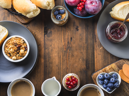 Cozy Breakfast concept on dark wooden textured background. Food frame flat lay