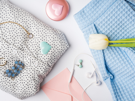 Spring woman clothes and accessories flat lay. Flower, hearts. Valentines, mother, womans day concept. Pastel colors Reklamní fotografie