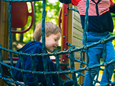 Little 5-year old boy playing on a playground. Active happy child