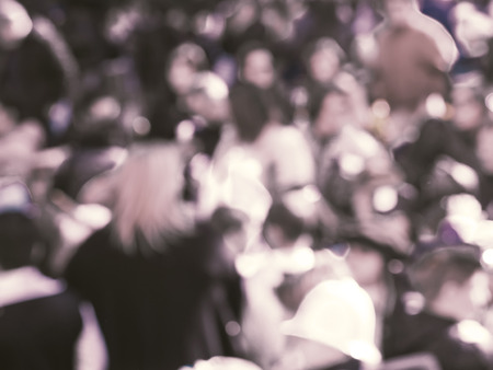 Crowd of people during festival defocused. Day. Desaturated colors