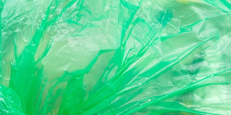 Color plastic bag with garbage to recycle outdoors. Texture