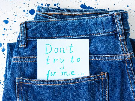 Dont try to fix me written message in jeans pocket. Broken relationship concept