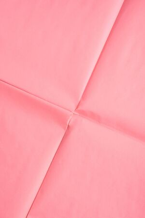 Pink coral wrapping paper background with crease texture. Geometry abstract art concept backdrop. Фото со стока