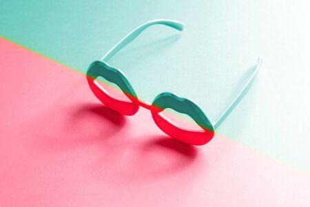 Lip shape glasses with neon color duotone gradient. Vaporwave aesthetics concept