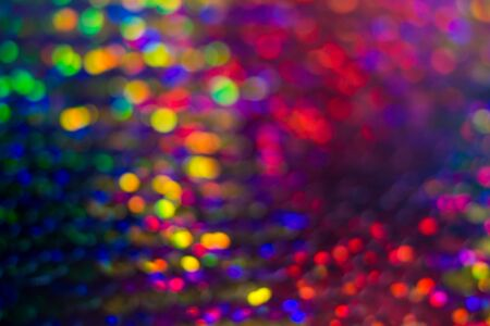 Shiny colorful sequin dress detail texture. Neon disco color Stock Photo