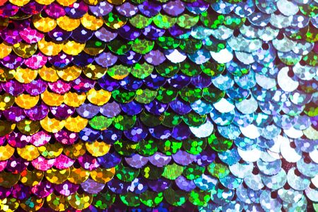 Shiny colorful sequin dress detail texture. Neon disco color Imagens