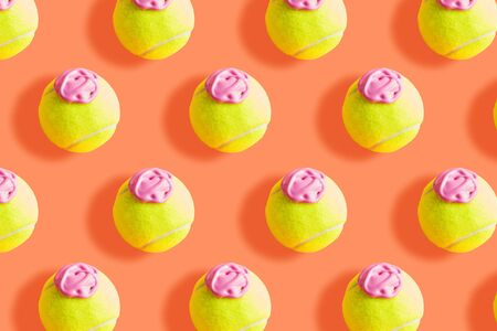 Tennis ball pattern with pink paint - ice cream imitation - on orange coral abstract background