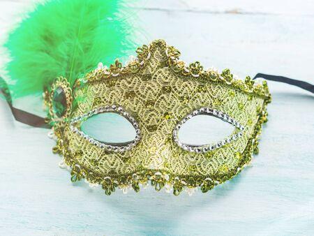 Carnival Mardi gras golden mask on table.