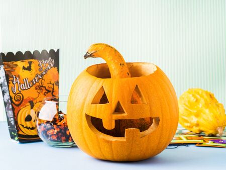 Halloween carved squash bright still life background. Holiday party