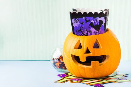 Halloween carved squash bright still life background. Holiday party 스톡 콘텐츠 - 130014314
