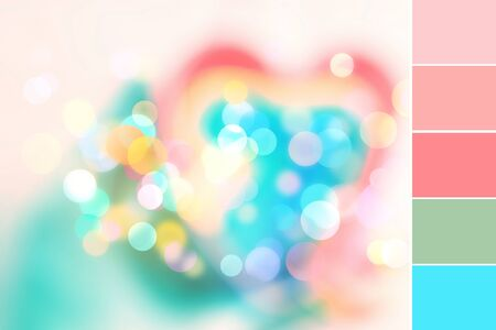 Abstract colorful blurred background with sparkling light bokeh and heart shape. Design color swatch