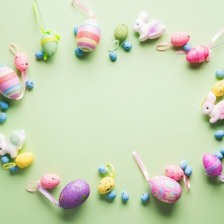 Easter colorful decor flat lay frame on green pastel background. Spring colors 스톡 콘텐츠