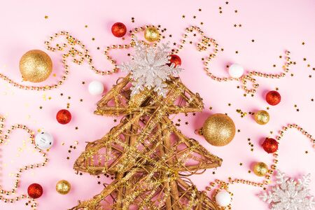 Christmas tree decorating concept flat lay on pink background. Festive flat lay