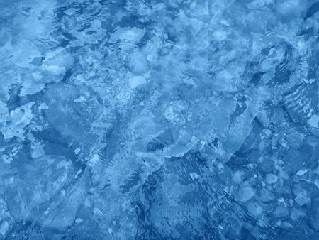 Classic blue color of 2020. Water surface with ripples. Natural background Stock Photo