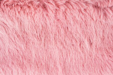 Faux fur detail flat lay monochrome pink color background for social media Stockfoto