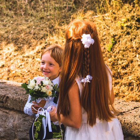 Ring bearer and flower girl at summer wedding in Italy.