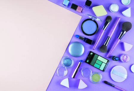 Make up accessory on purple and pink. Beauty products in classic blue colorful fashion flat lay