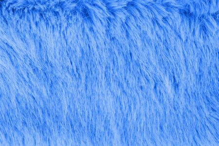 Faux fur detail flat lay monochrome classic blue color of 2020 color background for social media