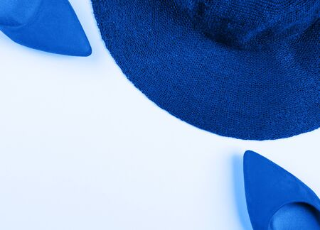Classic blue hat and pumps. Fashion concept flat lay with copy space