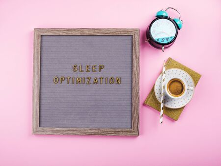 Sleep optimization text composed on wooden letter board with alarm clock, golden diary and cup of coffee. Better healthy sleep tips concept Stock Photo - 138190646