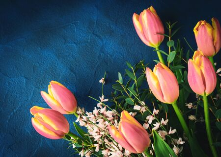 Pink tulips bouquet on classic blue color of 2020 concrete background. Womans day, Mothers day, Valentine.