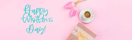 Gift box with heart, coffee and tulips on millennial pink background. Concept banner for mothers day.