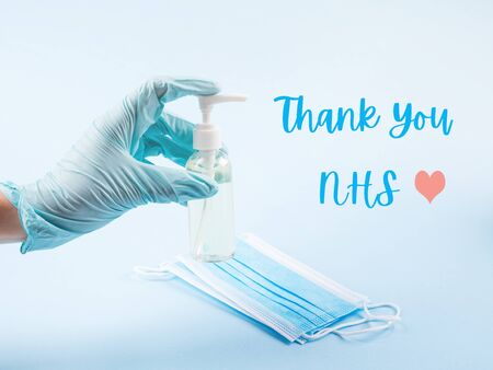 Thank you card for NHS staff, doctors and nurses who save lives every day. Gloved hand with medical tools and face masks