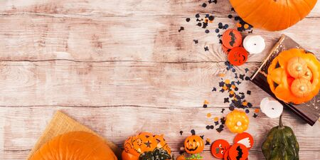 Autumn halloween moody background with candies and pumpkins. Trick or treat