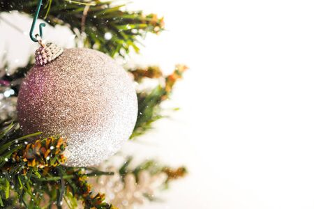 Christmas banner background with silver sphere on the branch of christmas tree