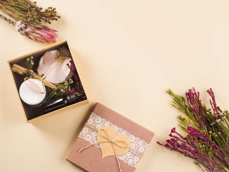 Zero waste beauty skin care gift box with flowers. Guasha, essential oil, bamboo toothbrushes