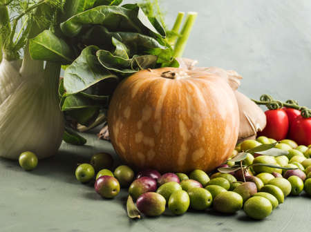 Green background with raw organic vegetable, fruit. Autumn, winter veggies concept, healthy food. Stok Fotoğraf
