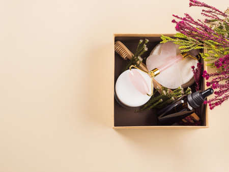 Zero waste beauty skin care gift box with flowers. Guasha, essential oil, bamboo toothbrushes Imagens