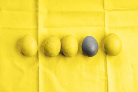 Easter illuminating yellow and ultimate gray eggs. Flat lay. Being unique concept