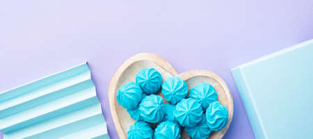 Blue turquoise meringue on heart shaped dish with gift box and decor