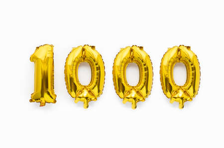 Number 1000 one thousand golden foil balloon party decor on white background, birthday anniversary