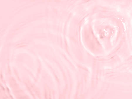 Pink water surface color background with ripples, circles and drops