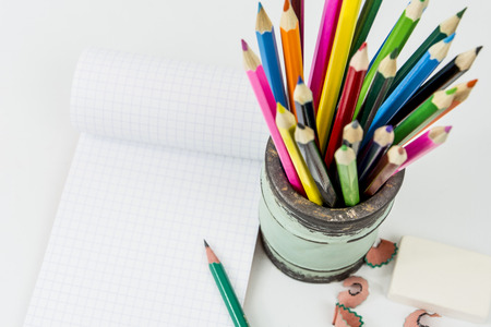 colored pencils: colored pencils with a small sketch book
