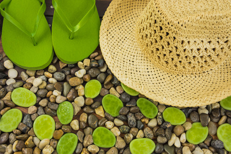 flip flop: ground gravel pebble with hat and flip flop Stock Photo