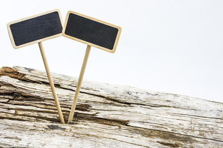 proclaim: small wooden sign stuck into a wooden board Stock Photo
