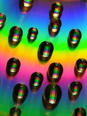 Water droplets on a vibrantly colored background Banco de Imagens