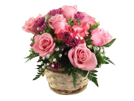 Arrangement of pink roses in a basket and isolated on white