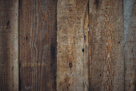 Vertical wooden planks forming a rough wood texture background