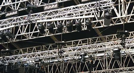 Concert stage spot lighting rigging structure for a live musical theater event