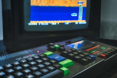 Mosta / Malta - July 3 2019: Amstrad CPC 464 keyboard and monitor displaying a retro computer game